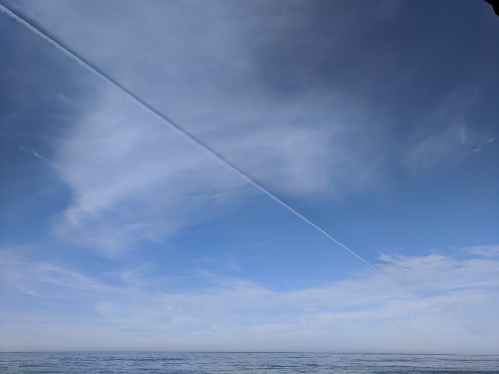 jet contrail and shadow in the blue sky